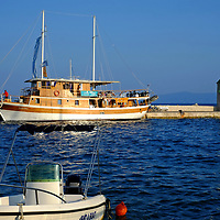 Bol Harbour Tower and Wall with large boat;<br />Bol, Brac, Croatia.