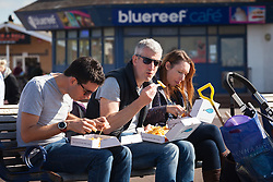 © Licensed to London News Pictures. 02/10/2016. Southsea, Hampshire, UK.  People eating their fish & chips on Southsea Promenade whilst enjoying the warm, sunny weather on another stunning autumn day. Photo credit: Rob Arnold/LNP