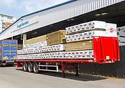 Anglo-Norden timber merchants warehouse and vehicles, Wet Dock, Ipswich, Suffolk, England, UK