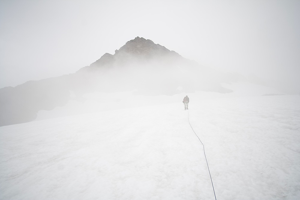 Kevin Steffa leads a climbing team across the Sulphide Glacier towards the summit pyramid of Mount Shuksan, North Cascades National Park, Washington.