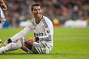 Cristiano Ronaldo smiles to referee
