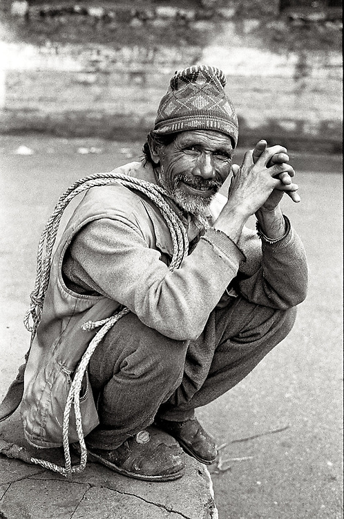 A porter is waiting for work on the street of Manali, India. Photo by Lorenz Berna