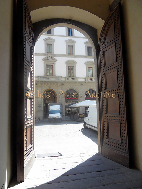Details from the Palazzo Strozzi in Florence, Italy. A symmetrical palace which began construction in 1489, and was completed in 1538. Commissioned for construction by Filippo Strozzi the Elder. Rusticated stone and beautiful archways are features of this building.