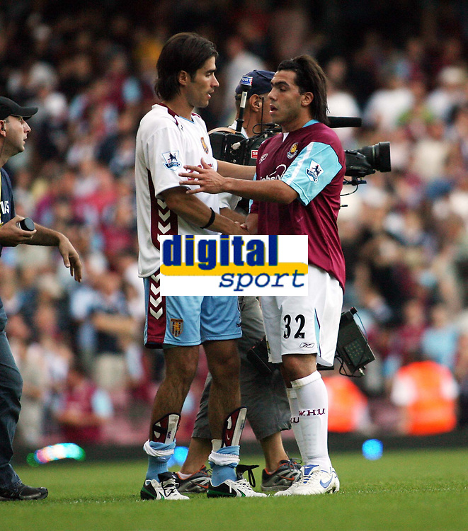 Photo: Chris Ratcliffe.<br /> West Ham United v Aston Villa. The Barclays Premiership. 10/09/2006.<br /> Carlos Tevez of West Ham shakes hands with Juan Pablo Angel of Villa at the end.