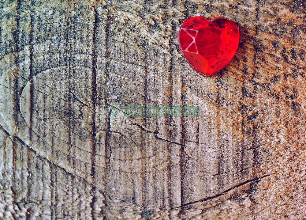 July 5, 2015 - Love for Valentine's day: a red glass heart on wooden background (Credit Image: © Igor Golovniov/ZUMA Wire/ZUMAPRESS.com)