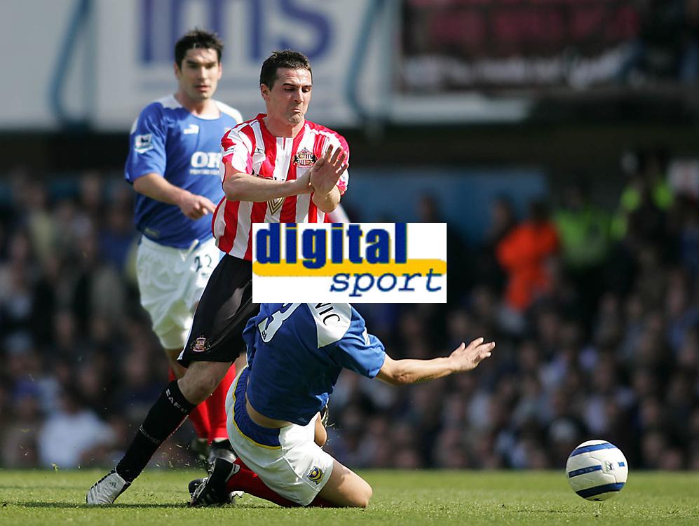 Photo: Lee Earle.<br /> Portsmouth v Sunderland. The Barclays Premiership. 22/04/2006. Sunderland's Tommy Miller (C) clashes with Dejan Stefanovic.