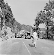 Y-570930-B01. Rock slide on old Columbia River Highway near Troutdale on Sandy River. Stark St. Bridge in background. September 30, 1957
