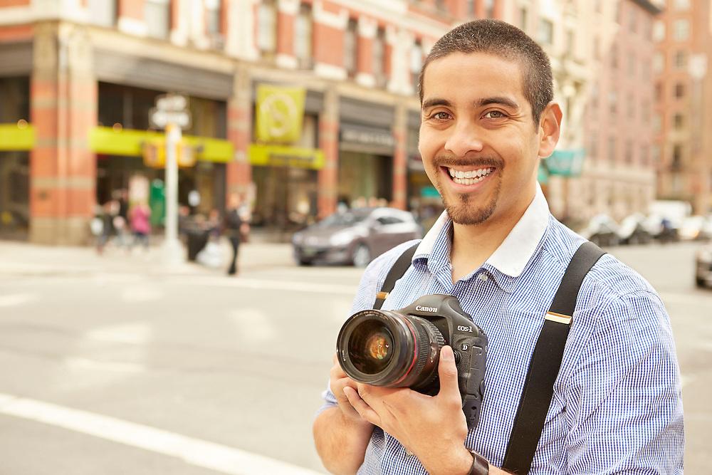 Portrait Photograph in New York City of smiling Hispanic professional photographer