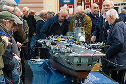 19/01/2018. London, UK. Model engineering enthusiasts admire a model of HMS Ark Royal (R09), built by Dave Fortey, at the London Model Engineering Exhibition at Alexandra Palace. Fortey, a former Royal Navy mechanic and sub-lieutenant, built the model over 25 years. It is the first time it has been put on display to the public. Photo credit: Rob Pinney