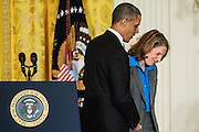 President Barack Obama escorts Sylvia Mathews Burwell out of the East Room of the White House after announcing her to head the Office of Management and Budget during a press conference in Washington, District of Columbia, U.S., on Monday, March. 4, 2013.