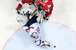 Rafael Rotter of Austria and Robert Kristan, goalkeeper of Slovenia during ice-hockey match between Austria and Slovenia of Group G in Relegation Round of IIHF 2011 World Championship Slovakia, on May 7, 2011 in Orange Arena, Bratislava, Slovakia. Austria defeated Slovenia 3-2. (Photo By Vid Ponikvar / Sportida.com)