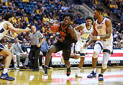 Jan 12, 2019; Morgantown, WV, USA; Oklahoma State Cowboys guard Isaac Likekele (13) drives towards the basket during the first half against the West Virginia Mountaineers at WVU Coliseum. Mandatory Credit: Ben Queen-USA TODAY Sports
