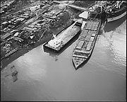 """Ackroyd 14339-5 """"Schnitzer Industires. Aerials of barge with whirly cranes. December 20, 1966"""""""