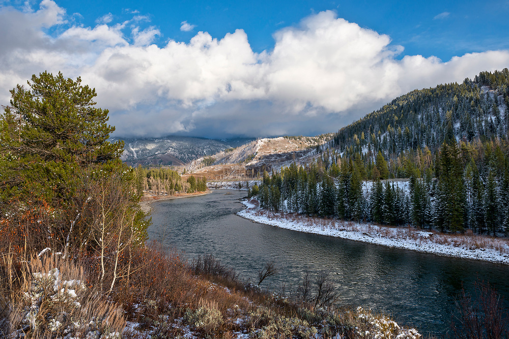 Early Snow in Late Autumn on the Snake River on the Hoback section through brilliant weather patterns and clouds in Wyoming. Licensing and Open Edition Prints.