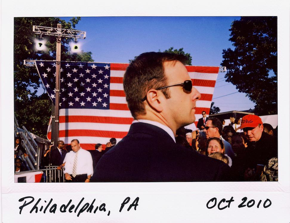 A U.S. Secret Service agent provides security for U.S. President Barack Obama at a rally at Vernon Park in Philadelphia, October 10, 2010.