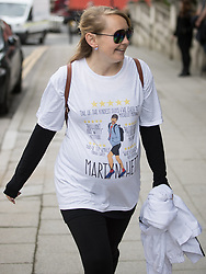 © Licensed to London News Pictures . 30/06/2017 . Stockport , UK . Mourners wearing Martyn Hett t-shirts outside the Town Hall ahead of the service . The funeral of Martyn Hett at Stockport Town Hall . Martyn Hett was 29 years old when he was one of 22 people killed on 22 May 2017 in a murderous terrorist bombing committed by Salman Abedi, after an Ariana Grande concert at the Manchester Arena . Photo credit : Joel Goodman/LNP