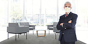 Businessman Standing in Empty Office Without Customers or Employees Wearing COVID-19 Face Mask