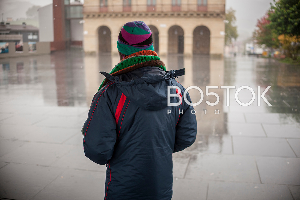 A young African migrant looks at the rainny weather. Irun (Basque Country). November 1, 2018. A group of volunteers has created a host network to serve migrants and inform about the public services they are entitled to and the ways to cross the border. This group of volunteers is avoiding a serious humanitarian problem Irun, the Basque municipality on the border with Hendaye. As the number of migrants arriving on the coasts of southern Spain incresead, more and more migrants are heading north to the border city of Irun. French authorities have reacted by conducting random checks as far as the city of Bordeaux, more than 200 kilometers north of the border. Migrants who are caught are then deported back to Irun. (Gari Garaialde / Bostok Photo).