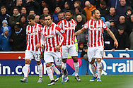 Marko Arnautovic of Stoke City (r) celebrates with his teammates after scoring his teams 2nd goal. Barclays Premier league match, Stoke city v Manchester city at the Britannia Stadium in Stoke on Trent, Staffs on Saturday 5th December 2015.<br /> pic by Chris Stading, Andrew Orchard sports photography.