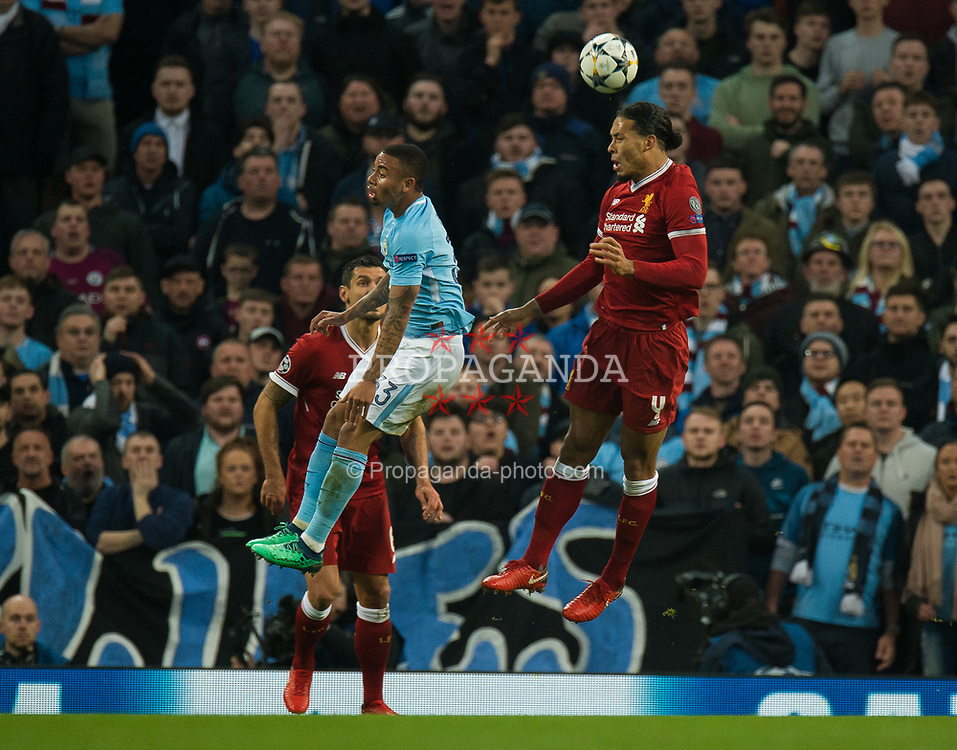 MANCHESTER, ENGLAND - Tuesday, April 10, 2018:  Gabriel Jesus of Manchester City (L) in action with Virgil van Dijk of Liverpool  (R) during the UEFA Champions League Quarter-Final 2nd Leg match between Manchester City FC and Liverpool FC at the City of Manchester Stadium. (Pic by Peter Powell/Propaganda)