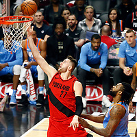 18 March 2018: Portland Trail Blazers center Jusuf Nurkic (27) goes for the lay up past LA Clippers center DeAndre Jordan (6) during the Portland Trail Blazers 122109 victory over the LA Clippers, at the Staples Center, Los Angeles, California, USA.