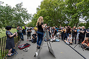 """An activist of """"Standing for Women"""" speaks to a gathered mass at Speakers' Corner in Hyde Park Central London, on Sunday, July 19, 2020 -  to what they said, """"speak, shout, sing and share our experiences of being adult human females in 2020."""" (VXP Photo/ Vudi Xhymshiti)"""