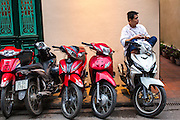 30 MARCH 2012 - HANOI, VIETNAM:   A man sits on his motorcycle in an alley in the Old Quarter of Hanoi, Vietnam.  PHOTO BY JACK KURTZ