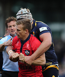 Bristol Rugby Scrum-Half Dwayne Peel (capt) is held back by Worcester Lock James Percival  - Photo mandatory by-line: Joe Meredith/JMP - Mobile: 07966 386802 - 27/05/2015 - SPORT - Rugby - Worcester - Sixways Stadium - Worcester Warriors v Bristol Rugby - Greene King IPA Championship