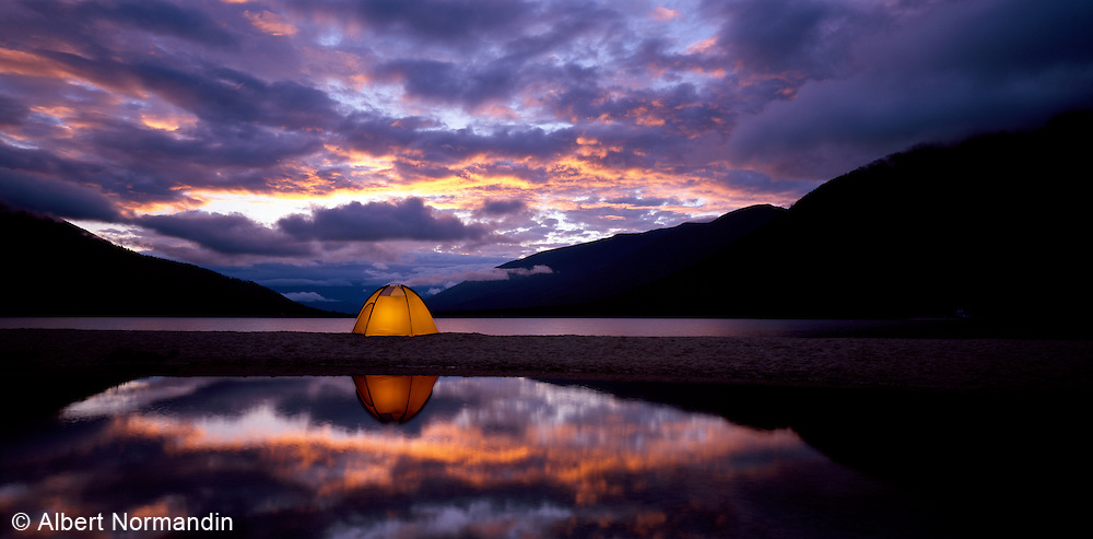 Kootney Lake with lamp inside tent before sunrise