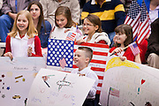 """15 JANUARY 2012 - PHOENIX, AZ:    Children wait for a family member to arrive at the The 161st Air Refueling Wing of the Arizona Air National Guard in Phoenix. About 100 soldiers of A (Alpha) Company of the 422nd Expeditionary Signal Battalion (referred to as """"Alpha 4-2-2"""") of the Arizona Army National Guard returned to Arizona on Sunday, Jan. 15, following a nearly year-long deployment to Afghanistan. More than 10,000 Arizona Army and Air National Guard Soldiers and Airmen have been ordered to federal active duty in support of Operations Noble Eagle, Enduring Freedom, Iraqi Freedom, and New Dawn since September 2001. Approximately 200 Arizona National Guard Soldiers and Airmen are still serving on federal active duty overseas.  Photo PHOTO BY JACK KURTZ"""