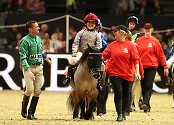 Flat Jockey Frankie Dettori congratulates son Rocco after he wins the Osborne refrigerators shetland Pony Grand National during day four of the London International Horse Show at London Olympia.