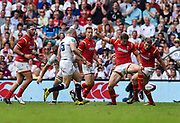 Wales' Hallam Amos kicks through a loose ball during the The Old Mutual Wealth Cup match England -V- Wales at Twickenham Stadium, London, Greater London, England on Sunday, May 29, 2016. (Steve Flynn/Image of Sport)