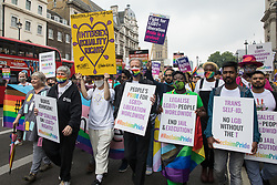 London, UK. 24th July, 2021. Peter Tatchell, veteran LGBTI+ and human rights campaigner, leads the first-ever Reclaim Pride march alongside Linda Riley and Phyll Opoku-Gyimah. Reclaim Pride replaced the traditional Pride in London march, which many feel has become too commercial and strayed from its roots in protest, and was billed as a People's Pride march for LGBTI+ liberation.