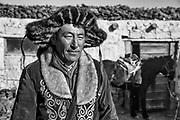 Portrait of Kazakh eagle hunter in black and white, Altai Mountains, Bayan Ulgii, Mongolia
