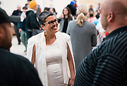 MMSD board member Ananda Mirilli, center, speaks with the public before the Madison Metropolitan School Board swearing-in ceremony at Cesar Chávez Elementary School in Madison, WI on Monday, April 29, 2019.