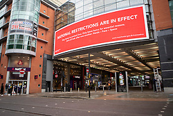 © Licensed to London News Pictures. 19/10/2020. Manchester, UK. A sign on Market Street, Manchester reminds people of national restrictions in place. Photo credit: Kerry Elsworth/LNP