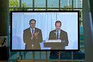 Garden City, New York, U.S. June 6, 2019. On stage are (at lecturn) MARC MACDONNELL, Chair, Board of Directors of Cradle of Aviation, and next to him, MICHAEL STROMER, JetBlue Chief Product Officer, Techology; as seen on giant screen in atrium of CAM, during Apollo at 50 Anniversary Dinner, an Apollo astronaut tribute celebrating the Apollo 11 mission Moon landing.