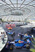 "Hangar-7; the spectacular home of the Flying Bulls (""Red Bull"" owner Didi Mateschitz' collection of classic airplanes) next to Salzburg W.A. Mozart airport. Red Bull Sauber Petronas Formula One and Indy racing cars, North American B-25J Mitchell twin-engine aircraft, Pitts S2B aerobatic double decker plane."