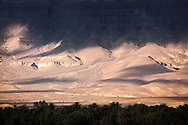 Jebel Kissane mountains in the Draa Valley during stormy weather, Sahara desert, Morocco.