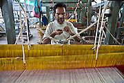 A blind man using a weaving loom at the training centre of the Blind People Association (Andhjan Mandal), Ahmedabad. India