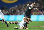 Malakai Fekitoa of the All Blacks smashes through the tackle of Kyle Eastmond of England during  the third rugby test between the All Blacks and England played at Waikato Stadium in Hamilton during the Steinlager Series - All Blacks v England, Hamiton, 21 June 2014<br /> www.photosport.co.nz