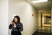 """SELMA, AL – DECEMBER 19, 2019: Keshee Dozier-Smith, 34, steps out of a YMCA Board of Directors meeting to take a call. Dozier-Smith took her seat on the Selma-Dallas County YMCA Board of Directors in September, 2019, and views her involvement there as an opportunity to encourage overall fitness and wellness within the community, and within the Rural Health Medical Program network. """"It's really part of our broader mission at Rural Health Medical Program – helping our patients connect with the community through health, fitness and wellness, and to bring people from different walks of life together.""""<br /> <br /> Since joining Rural Health Medical Program as Chief Executive Officer in March 2016, Dozier-Smith has effectively moderned the 35-year-old floundering business – opening three new clinics, streamlining processes and reaching out to local companies to offer healthcare services for employees. In the wake of rising hospital closures that leave Alabama's poorest citizens disproportionately cut off from access to medical care, Dozier-Smith represents a renewed effort to bridge the rural gap by offering a quality, affordable healthcare option."""
