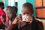 Learning to use a digital camera during a Seedlight photography workshop in Kenya