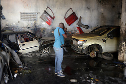 A photographer take pictures of the burnt vehicles at a Nigerian-owned garage in Johannesburg Town, South Africa, on April 17, 2015. South African police on Friday fired rubber bullets to disperse rioters in central Johannesburg, a fresh hotbed of xenophobia violence. The current spate of xenophobic violence mainly affects Durban and Johannesburg. According to official figures, five people have been killed and thousands of immigrants displaced. EXPA Pictures © 2015, PhotoCredit: EXPA/ Photoshot/ Zhai Jianlan<br /> <br /> *****ATTENTION - for AUT, SLO, CRO, SRB, BIH, MAZ only*****