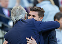 Football - 2018 / 2019 Premier League - West Ham United vs. Tottenham Hotspur<br /> <br /> Manuel Pellegrini, manager of West Ham United,  and Mauricio Pochettino, Manager of Tottenham FC, embrace at the begining of the game at the London Stadium<br /> <br /> COLORSPORT/DANIEL BEARHAM