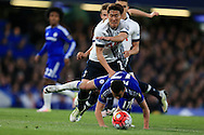 Pedro of Chelsea is tackled by Son Heung-Min of Tottenham Hotspur. Barclays Premier league match, Chelsea v Tottenham Hotspur at Stamford Bridge in London on Monday 2nd May 2016.<br /> pic by Andrew Orchard, Andrew Orchard sports photography.