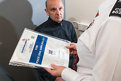 PACE DNA swab kit in UK police station - Group 4 Securicor civilian worker