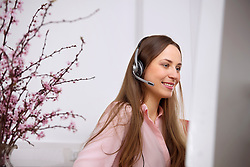 Young woman computer call-centre pretty headset