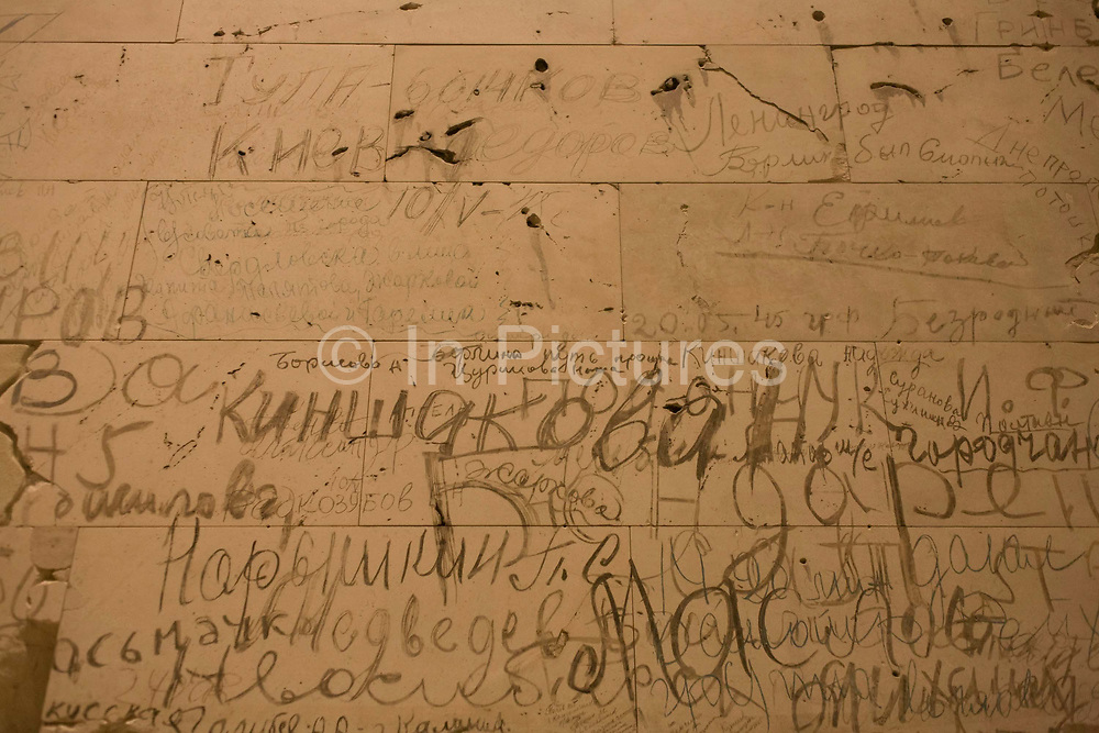 The graffiti left on walls inside the Reichstag building by Soviet soldiers after their battles in the German capital at the end of the second world war. The building, having never been fully repaired since the fire, was damaged by air raids. During the Battle of Berlin in 1945, it became one of the central targets for the Red Army to capture due to its perceived symbolic significance. Today, visitors to the building can still see Soviet graffiti on smoky walls inside as well as on part of the roof, which was preserved during the reconstructions after reunification.