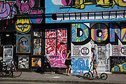 Street art by various artists covers the closed down Lord Napier pub in Hackney Wick, East London, United Kingdom. Street art in the East End of London is an ever changing visual enigma, as the artworks constantly change, as councils clean some walls or new works go up in place of others. While some consider this vandalism or graffiti, these artworks are very popular among local people and visitors alike, as a sense of poignancy remains in the work, many of which have subtle messages.